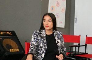 Alexandria Ocasio-Cortez sitting